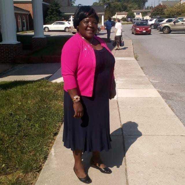 Black dress and pink cardigan
